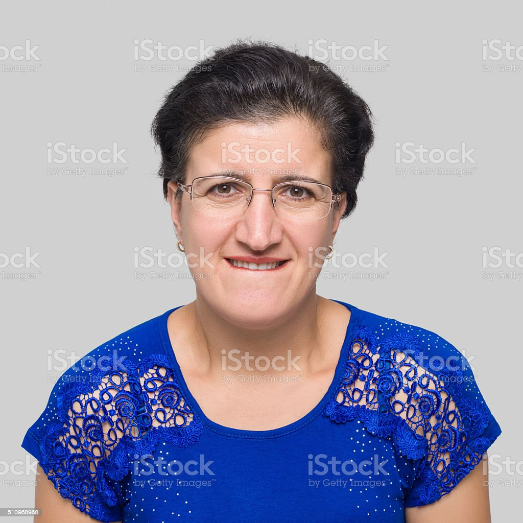 Woman making a frightened face expression stock photo