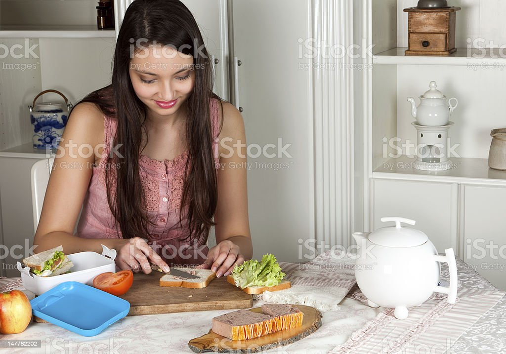 Woman making a lunchbox royalty-free stock photo