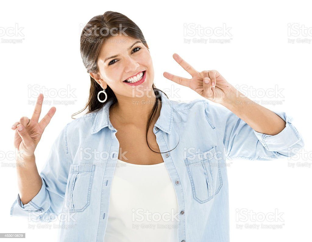 Woman making a peace sign stock photo