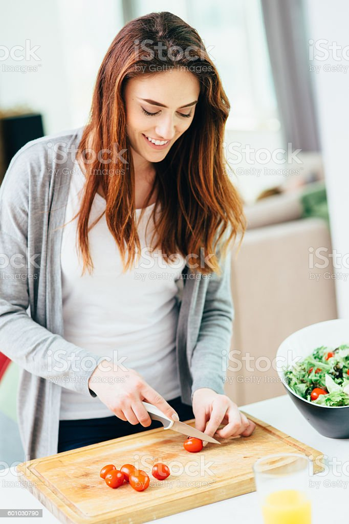 Woman making a salad stock photo