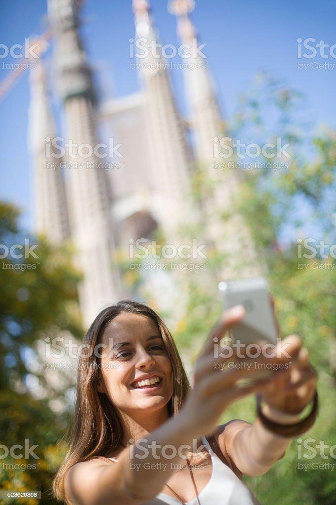 Woman making a selfie in  Barcelona. stock photo