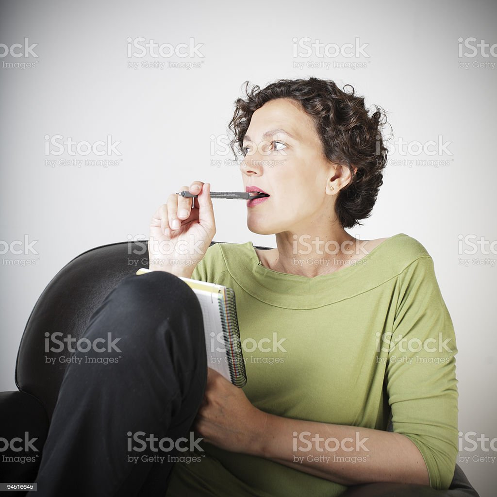 woman making a shopping list royalty-free stock photo