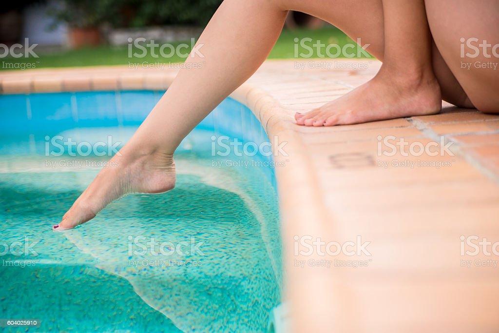 Woman Making a tiny splash before the big dip stock photo