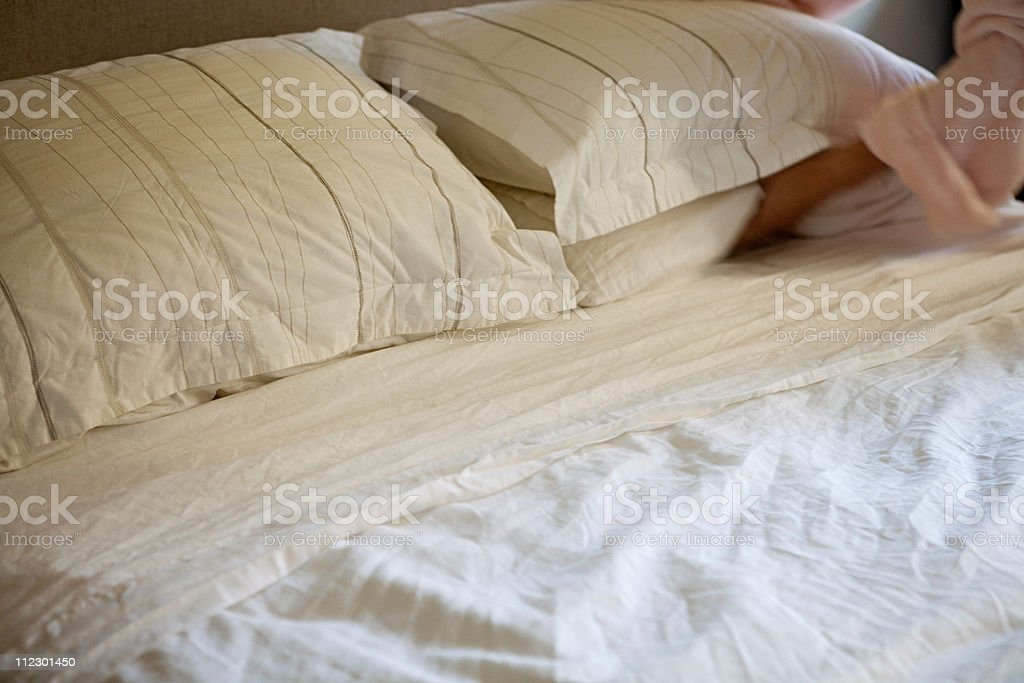 Woman making bed stock photo
