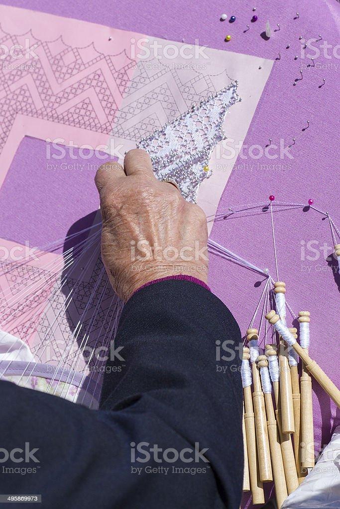 Woman Making Bobbin Lace. royalty-free stock photo