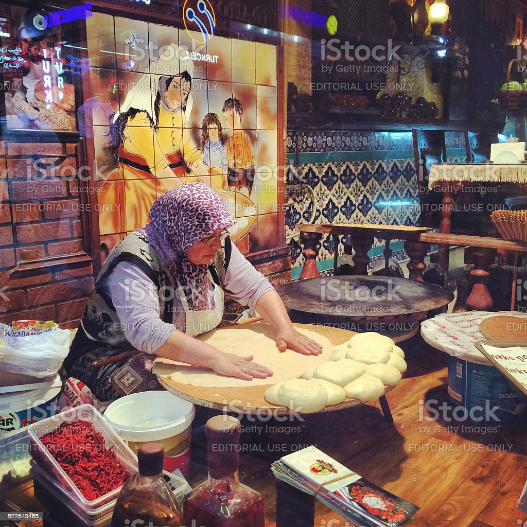 Woman making bread in a cafe stock photo