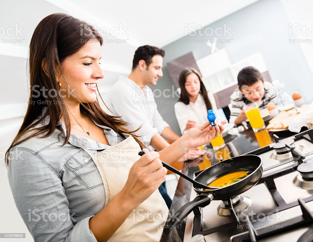 Woman making breakfast stock photo