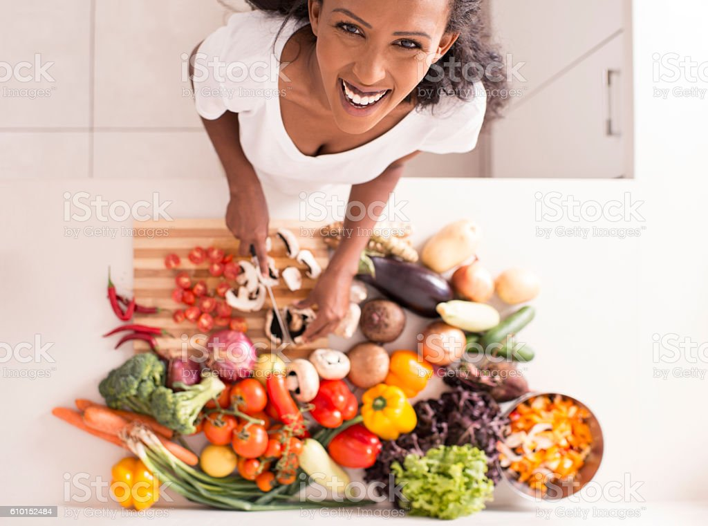 Woman making breakfast. stock photo