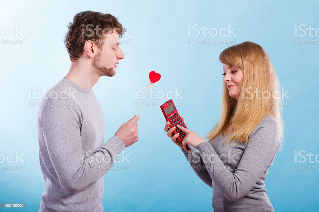 Woman making calculation of relationship. stock photo