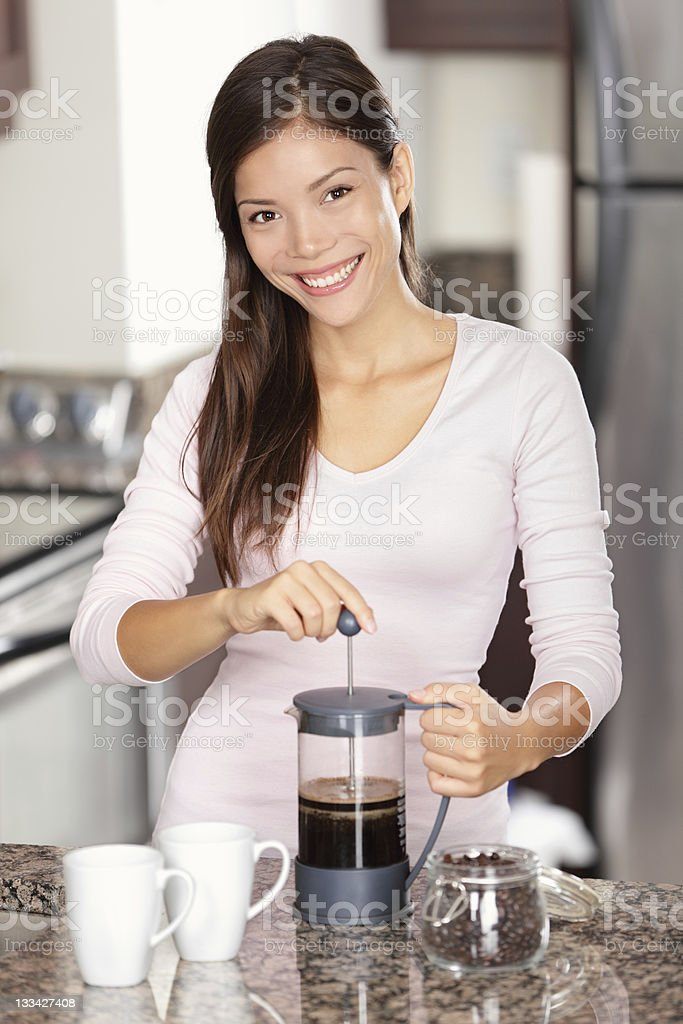 woman making coffee in kitchen royalty-free stock photo
