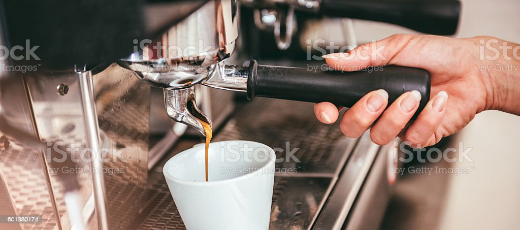 Woman making coffee stock photo