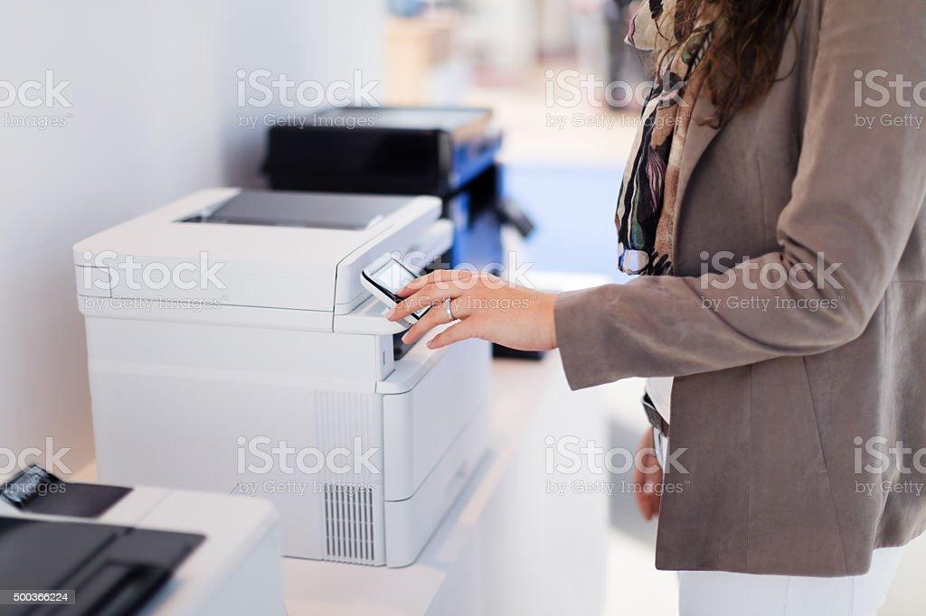 Woman making copies stock photo