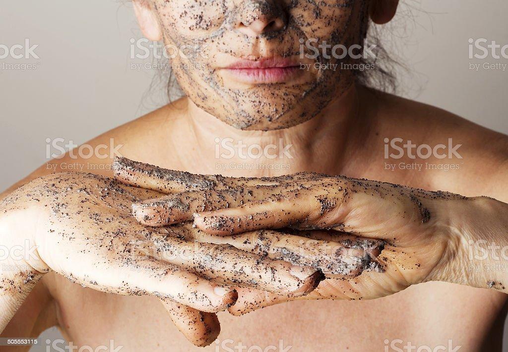 Woman making cosmetic mask stock photo
