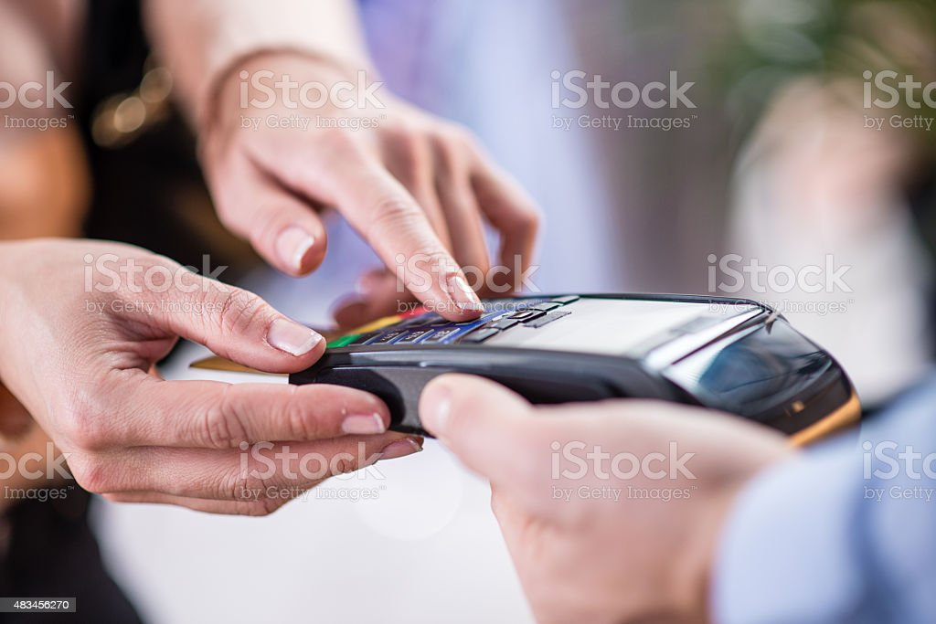 Woman making credit card payment stock photo