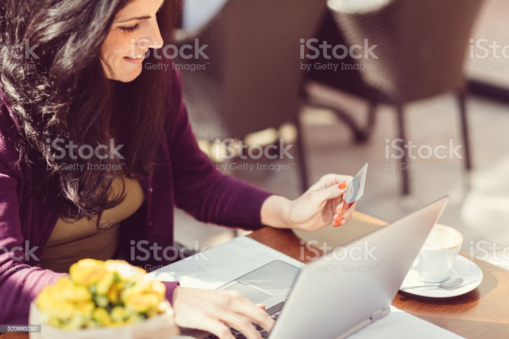 Woman making credit card purchase online stock photo