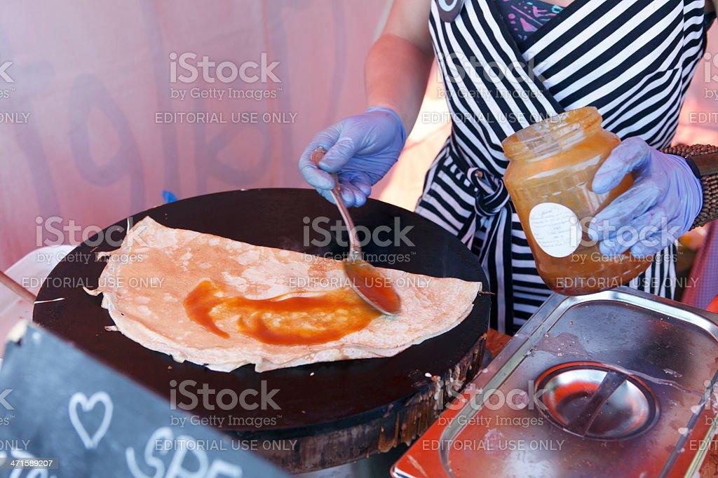 Woman making crepe pancake royalty-free stock photo