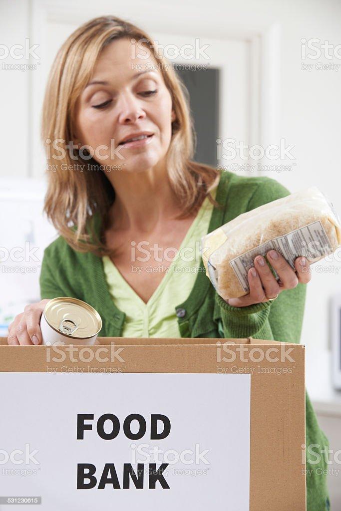 Woman Making Donation To Food Bank stock photo