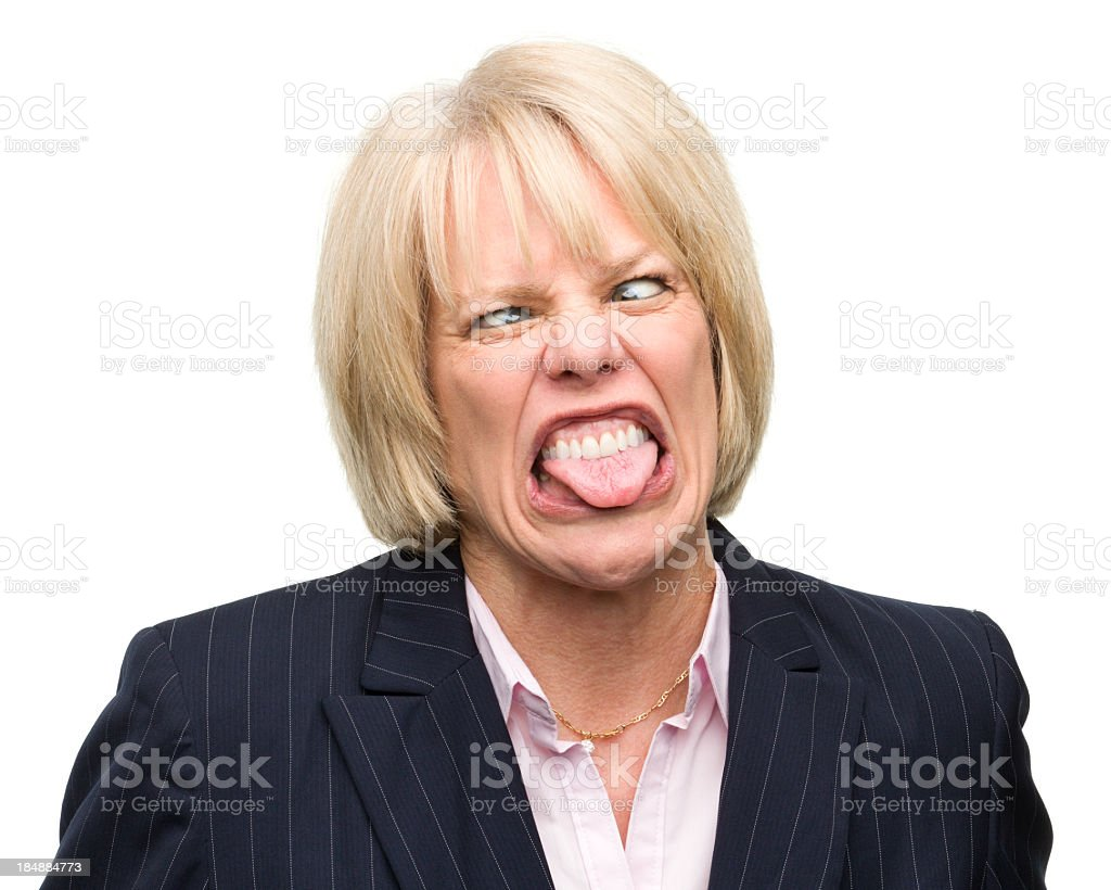 Woman Making Face Sticking Out Tongue royalty-free stock photo