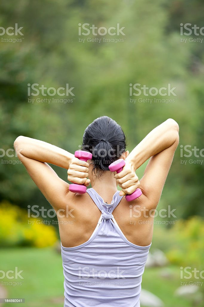 Woman making fitness exercises royalty-free stock photo