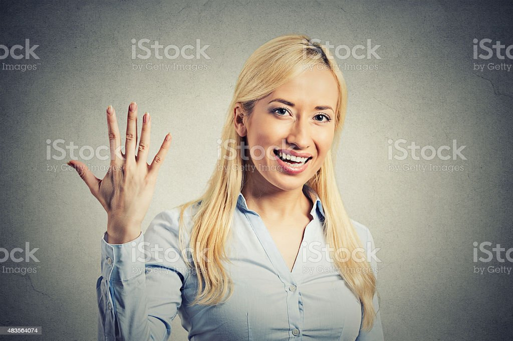 woman, making five times sign gesture with hand fingers stock photo