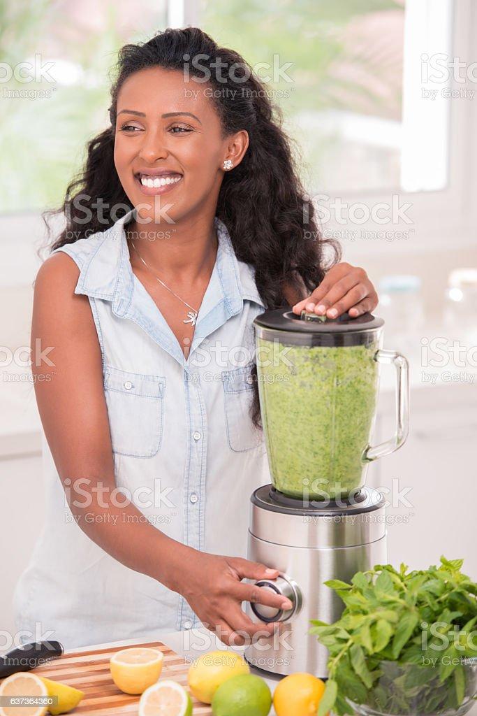 Woman making fresh lemonade in a beautiful sunny morning. stock photo