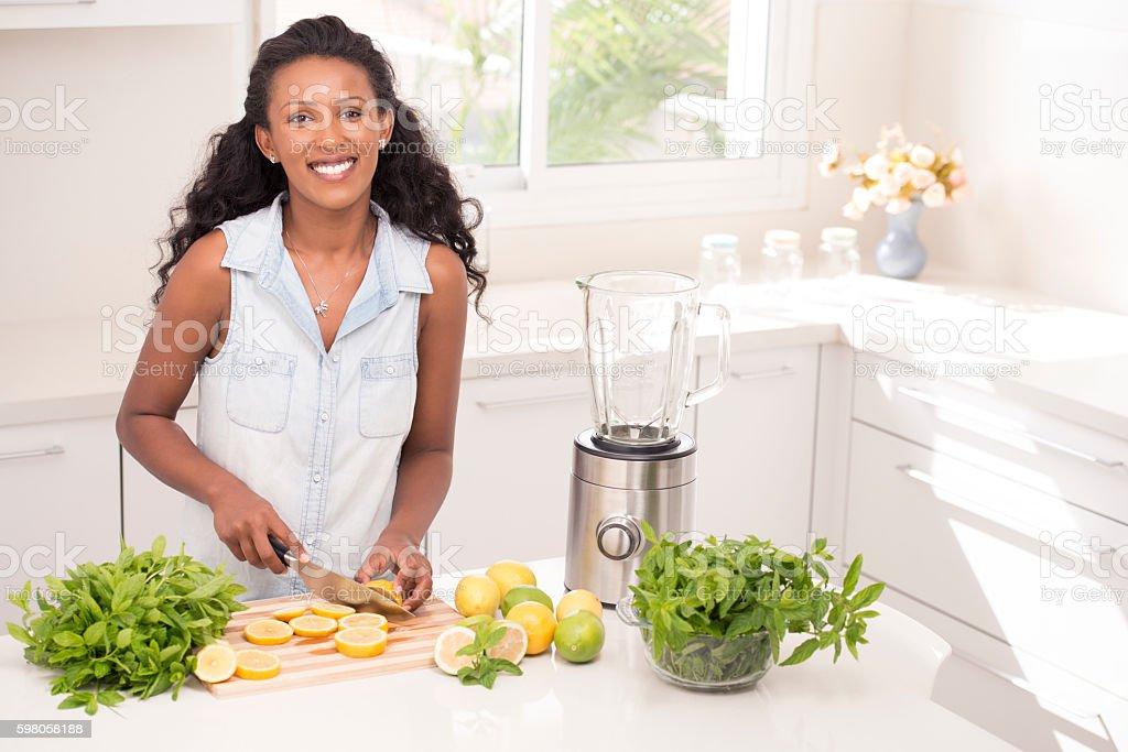 Woman making fresh lemonade. stock photo