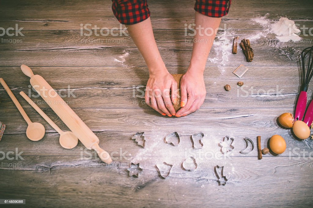 woman making gingerbread and cookies stock photo