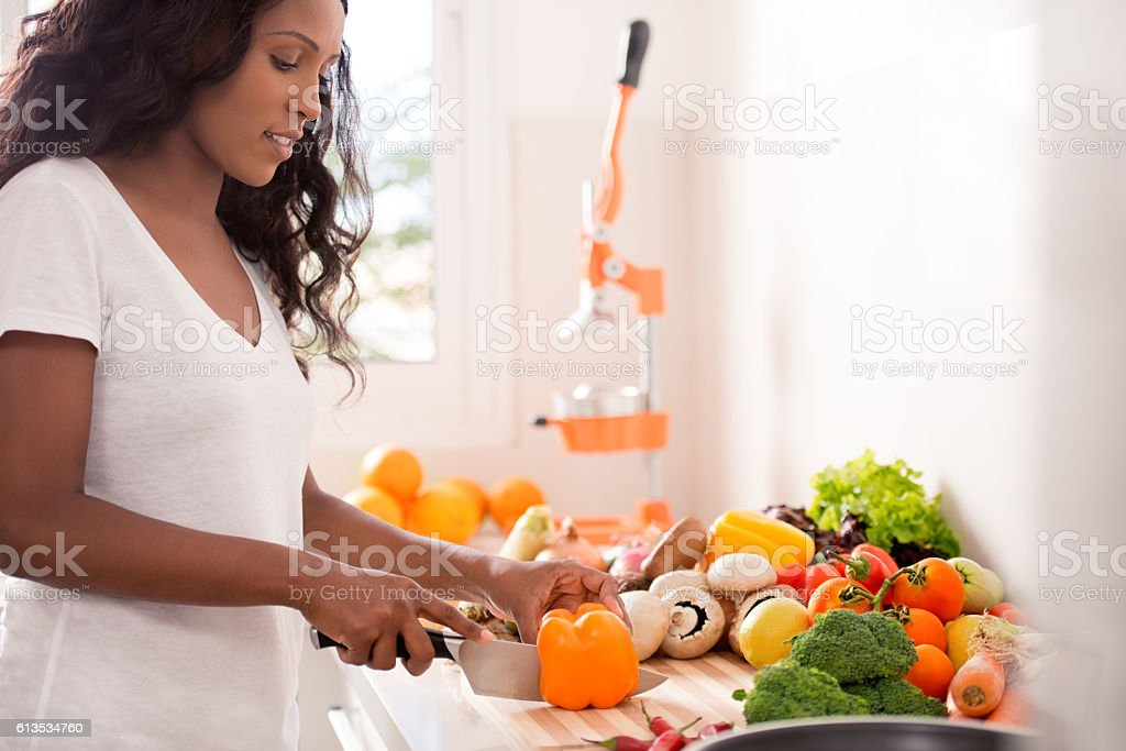 Woman making healthy vegetable salad meal. stock photo