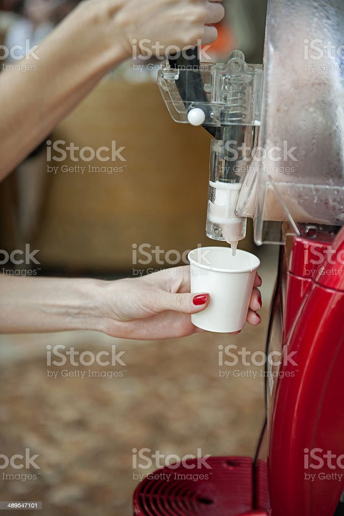 Woman making herself coffe from coffee maker stock photo