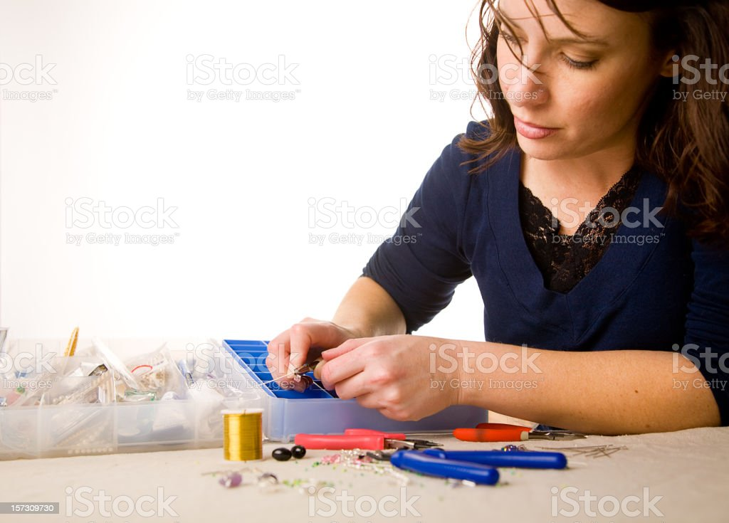 Woman Making Jewelry royalty-free stock photo