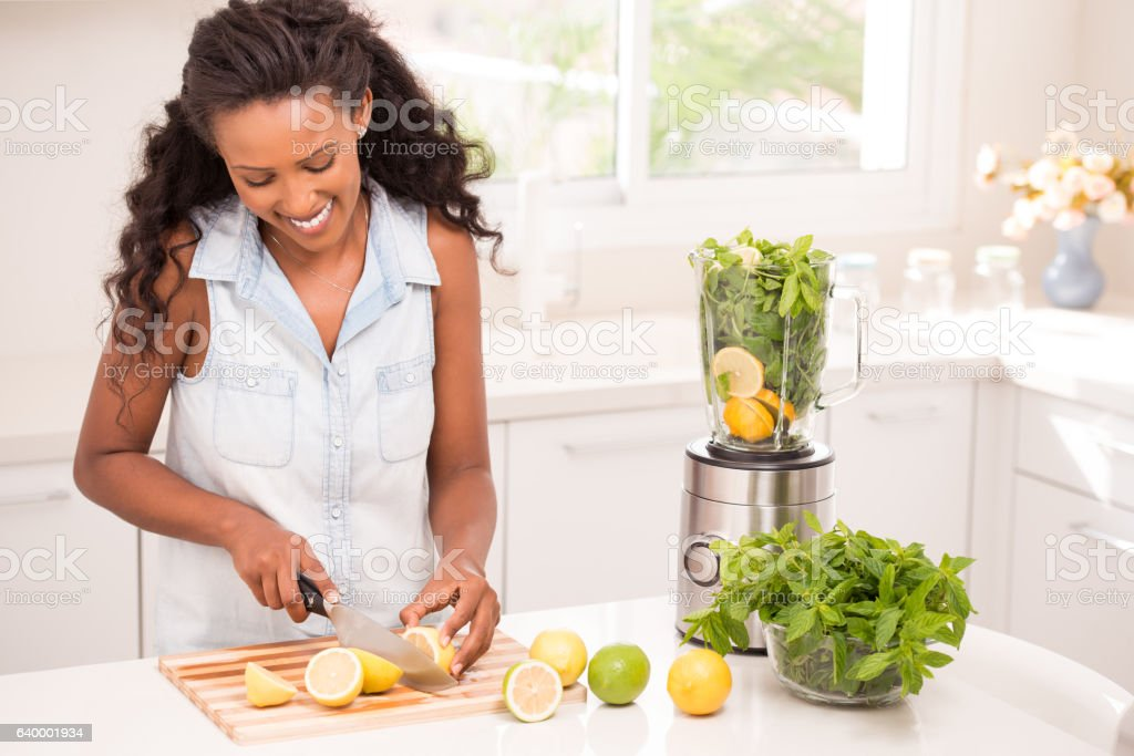 Woman making lemonade. stock photo