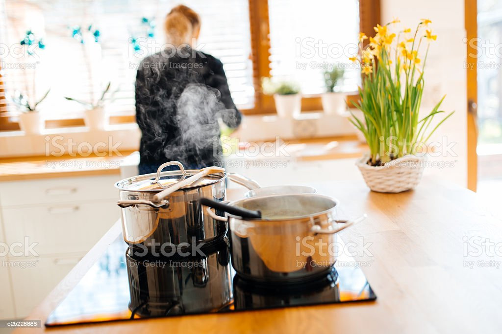 Woman making lunch in kitchen stock photo