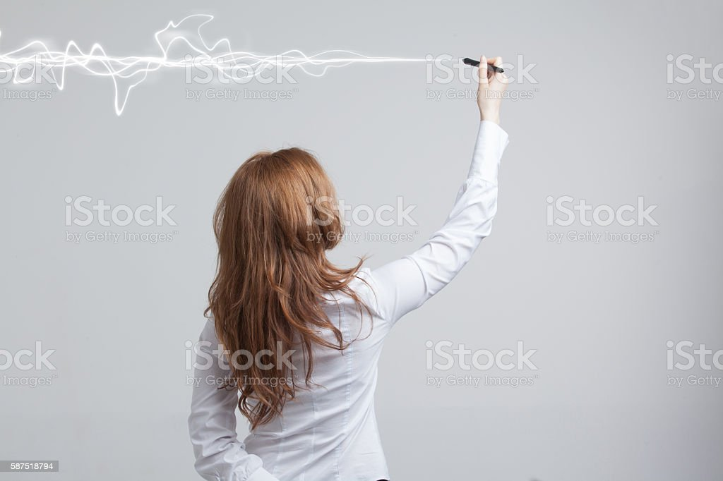 Woman making magic effect - flash lightning. The concept of stock photo