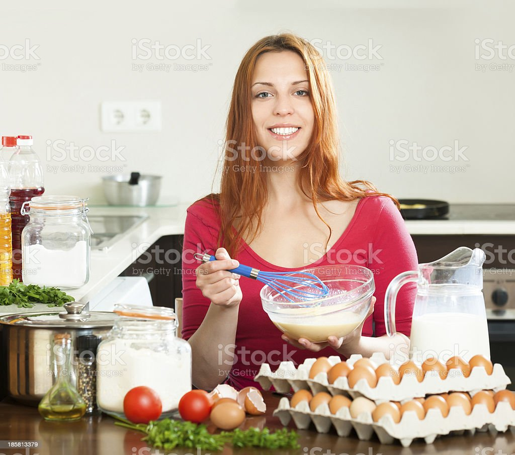 woman  making  omlet in  kitchen royalty-free stock photo