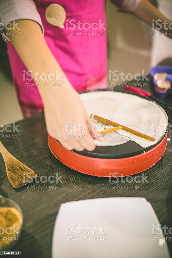 Woman making pancakes. stock photo
