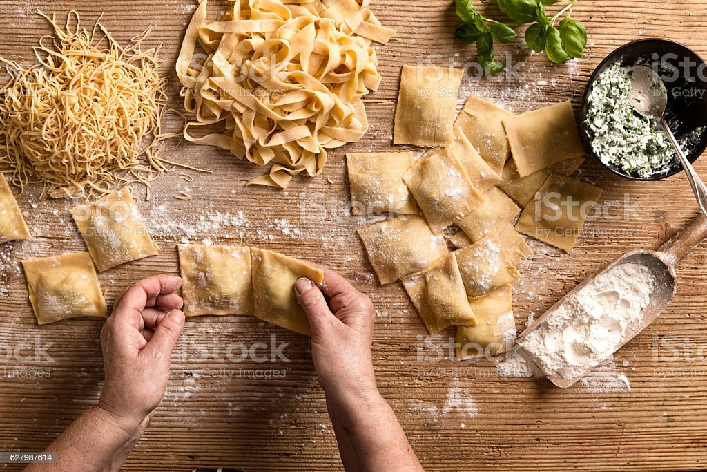 Woman making pasta stock photo