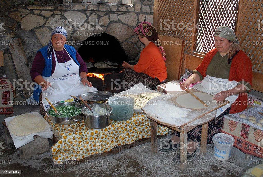 woman making pastry (gözleme) stock photo