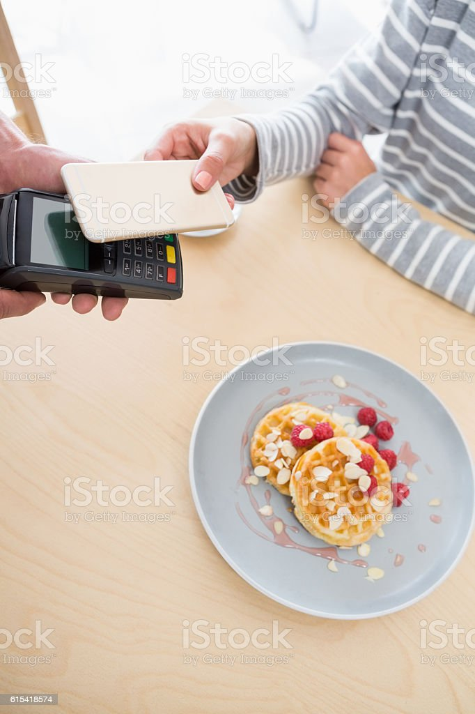 Woman making payment stock photo