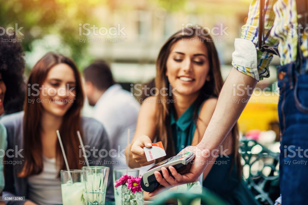 Woman making payment with credit card stock photo