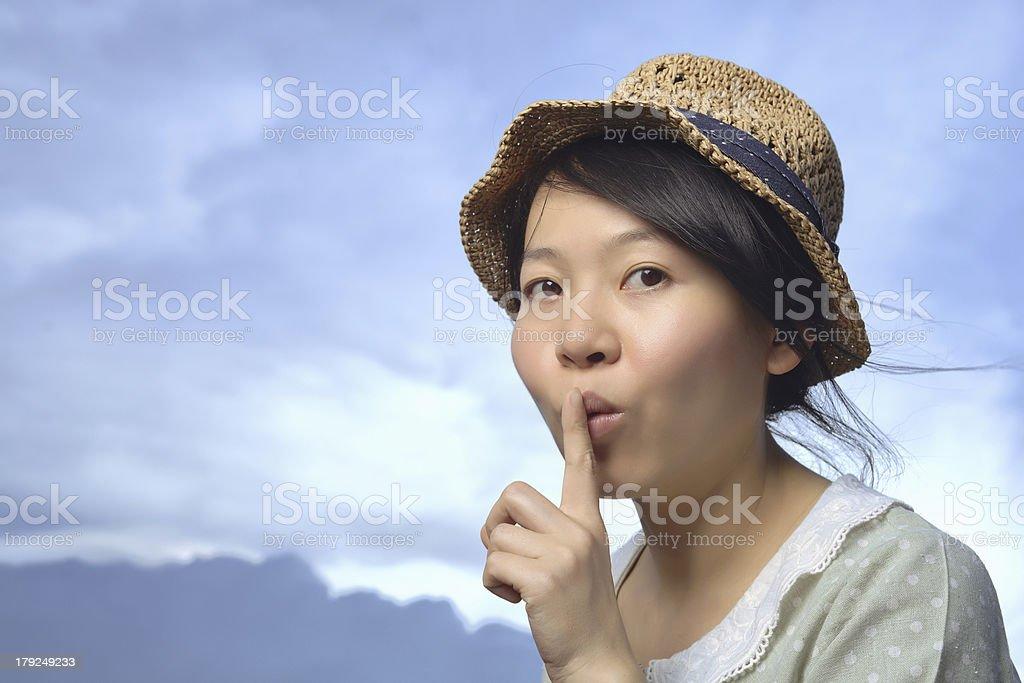 Woman making secret gesture royalty-free stock photo