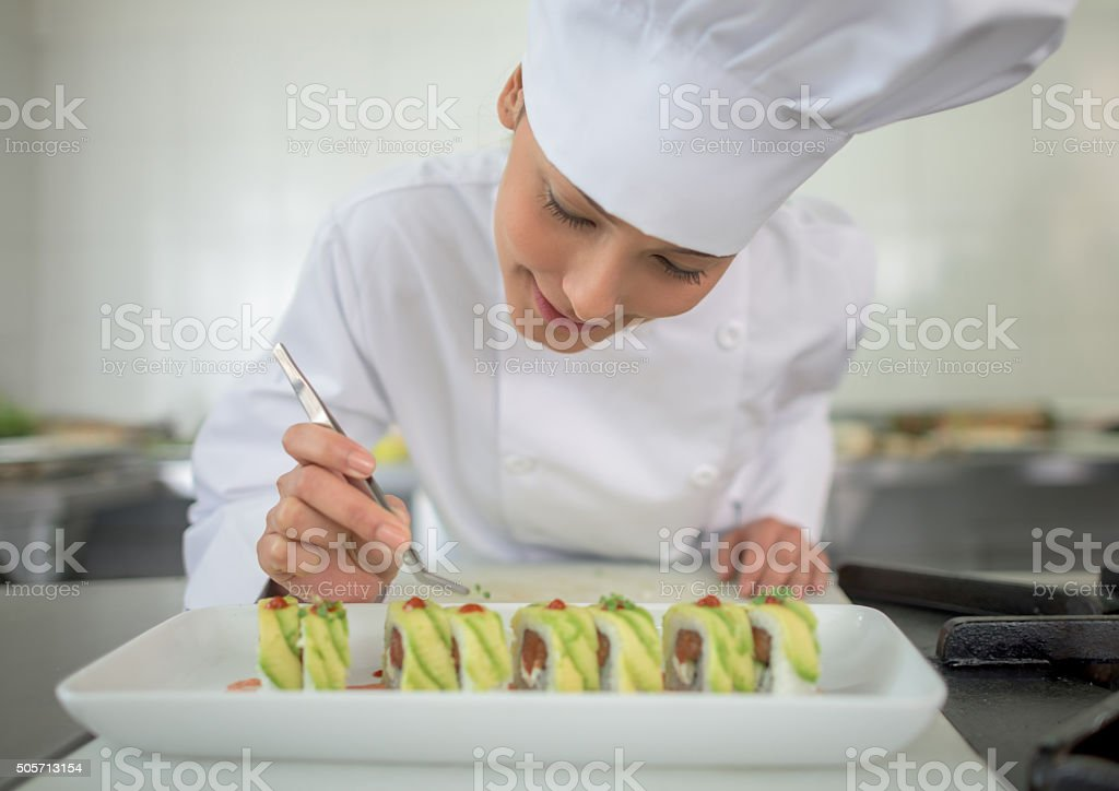 Woman making sushi stock photo