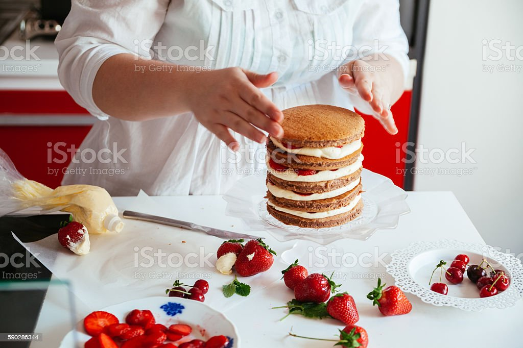Woman Making The Naked Cake stock photo