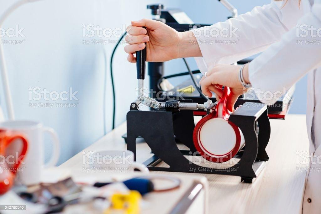 Woman making thermal transfer print stock photo