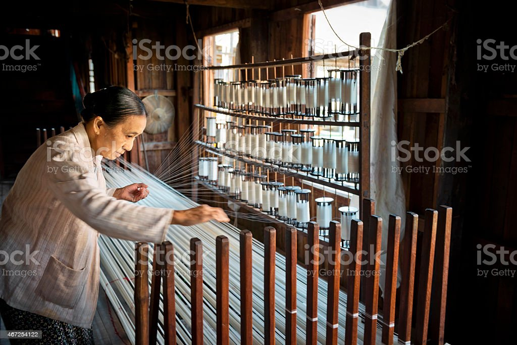 Woman Making Thread From Lotus Fibre stock photo