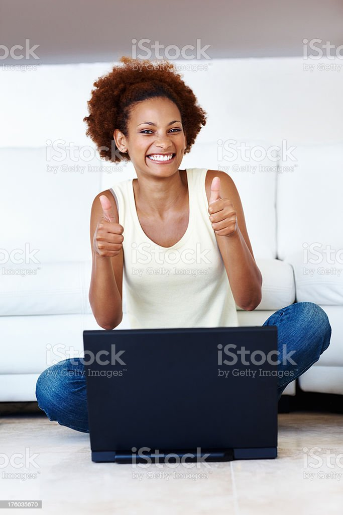 Woman making thumbs up gesture stock photo