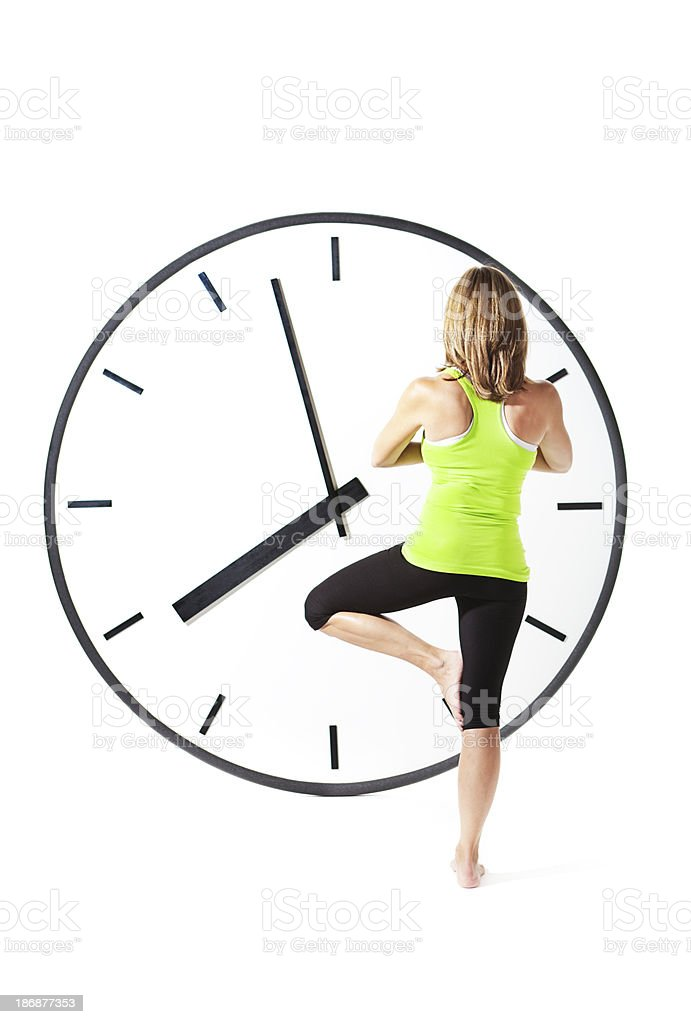 Woman Making Time for Exercise and Yoga in Healthy Lifestyle royalty-free stock photo