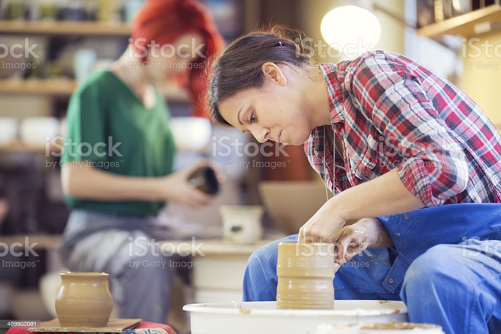 woman making vase on pottery wheel stock photo