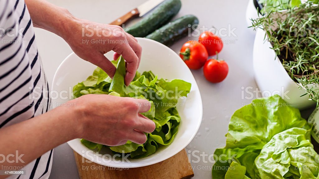 woman making vegetable salad stock photo