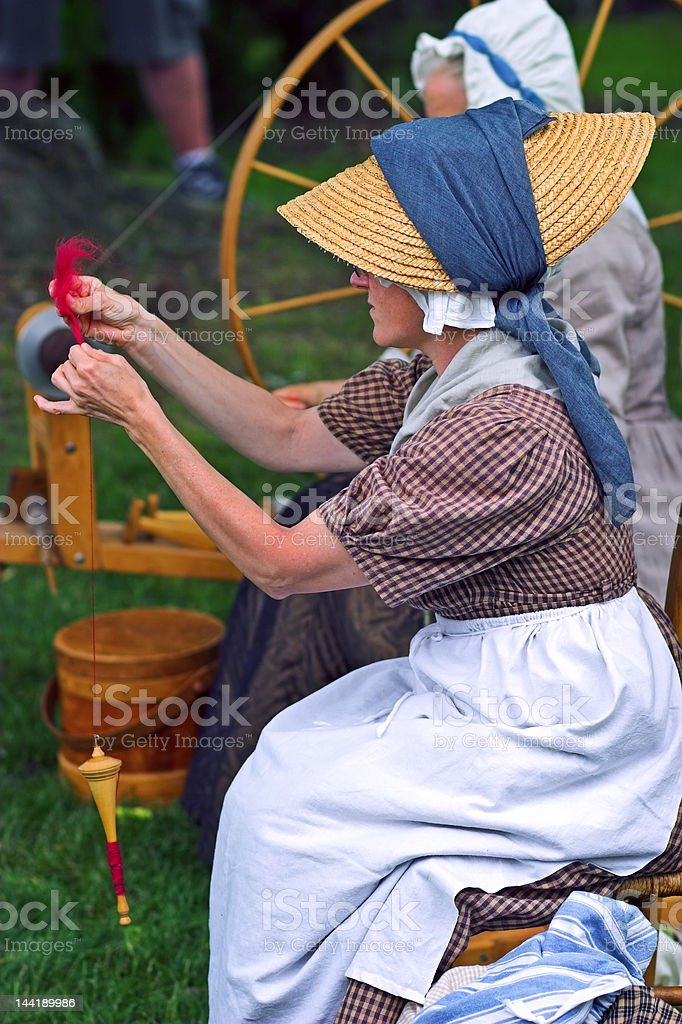 Woman making yarn royalty-free stock photo