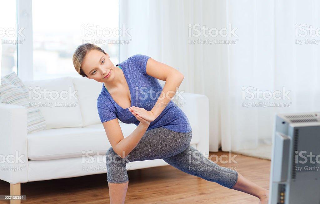 woman making yoga low angle lunge pose on mat stock photo